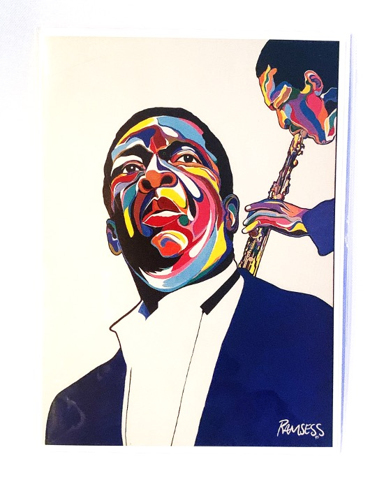John Coltrane notecard with art and bio on the back. Art by Kisasi Ramsess, Los Angeles black artist. Custom framing at Serengeti Gallery.