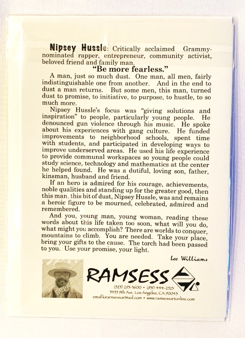 Nipsey Hussle notecard with art and bio on the back. Art by Kisasi Ramsess, Los Angeles black artist. Custom framing at Serengeti Gallery.